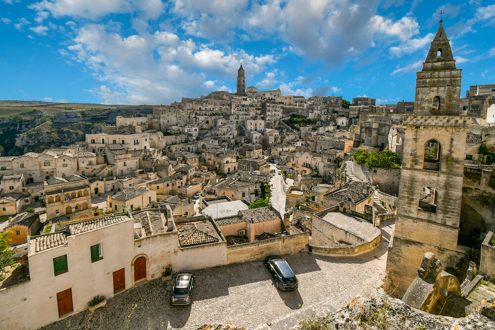 Matera, Italy - View of the Sasso Barisano, tower, old town, sassi caves and tourist area from the Convent of San Agostino, in the prehistoric city of Matera, Italy