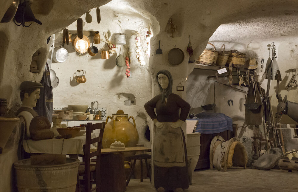 MATERA, ITALY - old cavern house in Materia, reconstruction of how families lived in that house