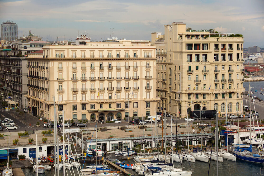 NAPLES, ITALY - Air view of the Grand Hotel Santa Lucia and Hotel Excelsior in historical center of Naples near gulf embankment. Viiw from the castle Castel dell Ovo.