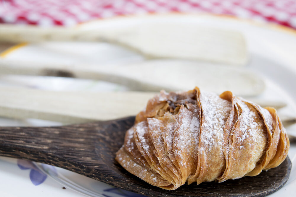 neapolitan sfogliatella a puff filled with ricotta and candied fruit