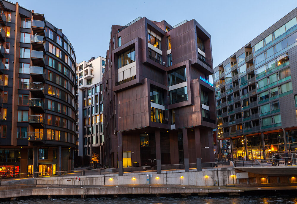 OSLO, NORWAY - Modern hotels from glass and concrete. New artificial islands named Holmen.