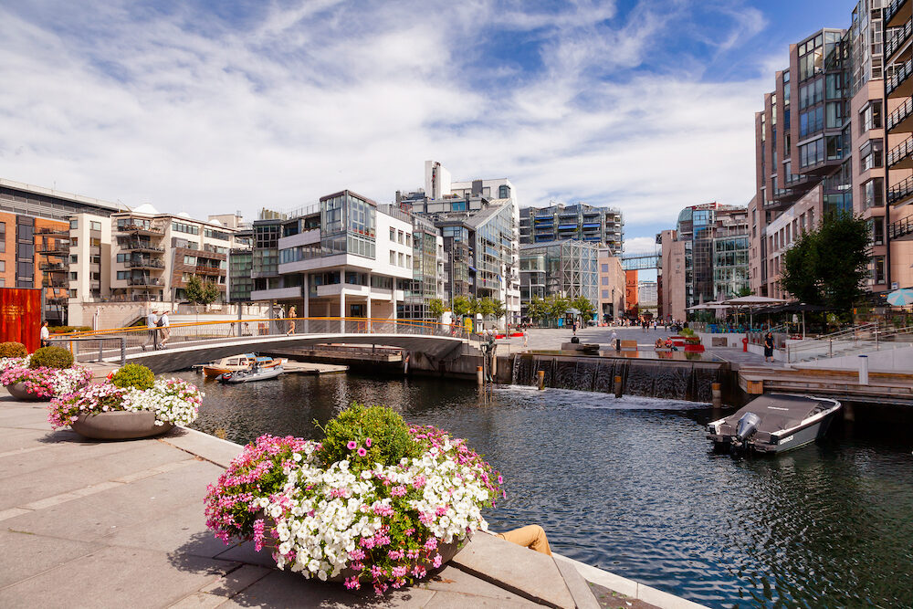 OSLO, NORWAY - : Modern scandinavian architecture at renovated Aker Brygge neighbourhood, part of the Fjord City urban renewal project in Oslo