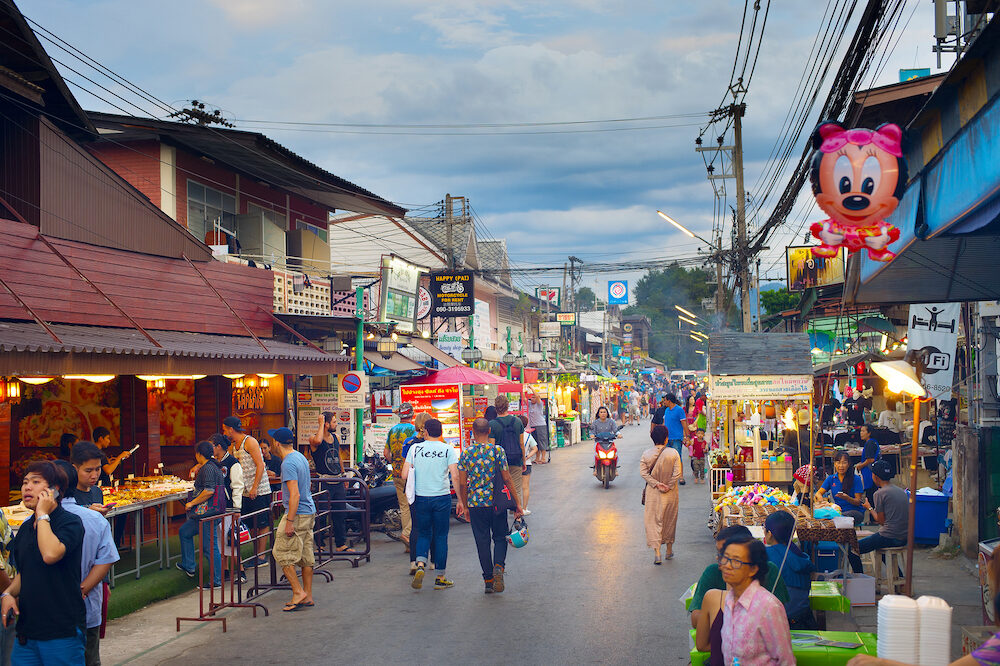 PAI THAILAND - People walking on Pai night market at twilight. Pai is the famous tourist attraction in Thailand