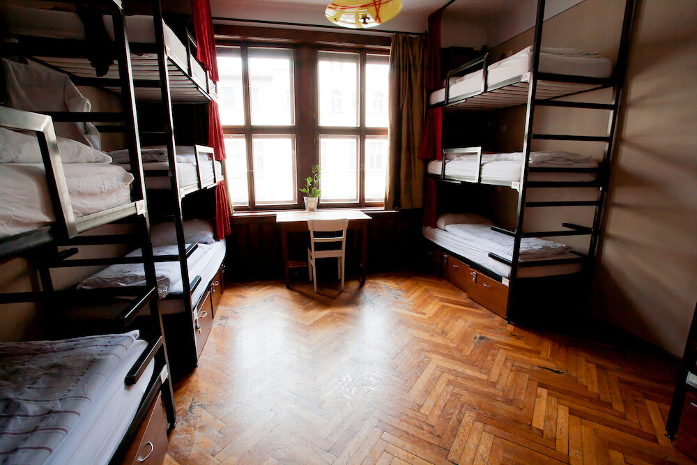 PRAGUE, CZECHIA - Clean bedroom without people inside a hostel for youth tourists on May 14, 2014. Prague receives more than 4.4 million international visitors annually