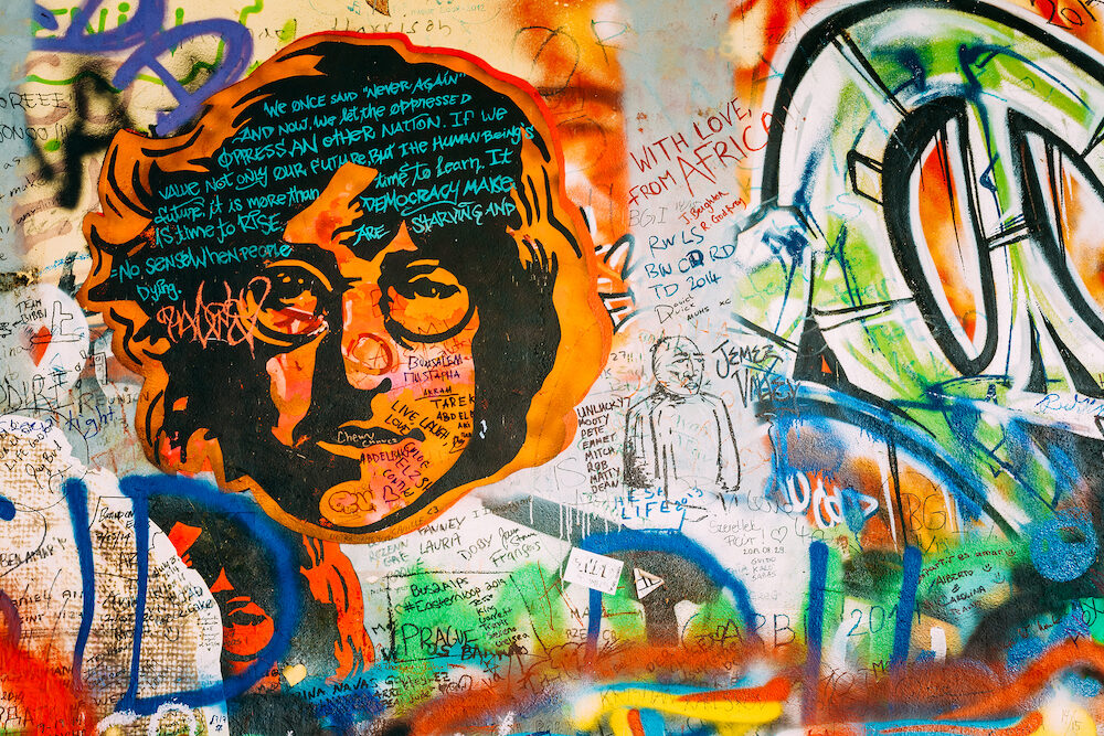 Prague, Czech Republic - Famous place in Prague - The John Lennon Wall. Wall is filled with John Lennon inspired graffiti and lyrics from Beatles songs
