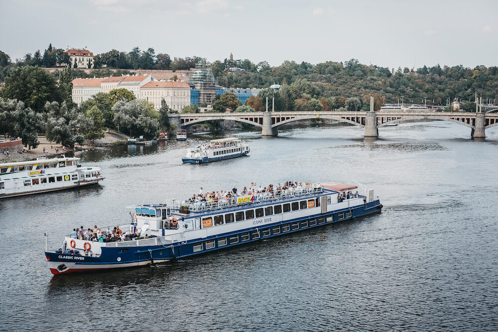 Prague, Czech Republic - Tour boats on Vltava river in Prague. Vltava is the longest river within the Czech Republic.