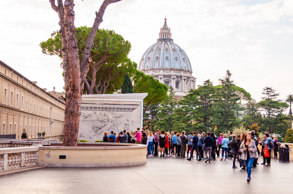 Vatican, Rome, Italy - Tourists in Pine outdoor yard of Vatican museums in Vatican city. The Galleries display works from collections built up by the Popes throughout the centuries