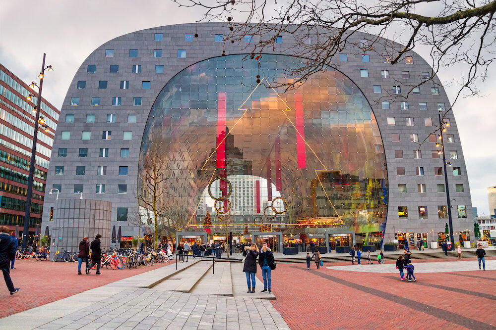 Christmas cityscape on the sunset - view of the Market Hall (Markthal) on the eve of the holiday, Rotterdam, Netherlands,