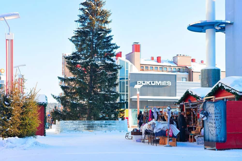 Rovaniemi Finland - People at Lordi Square in Rovaniemi in winter Lapland Finland.