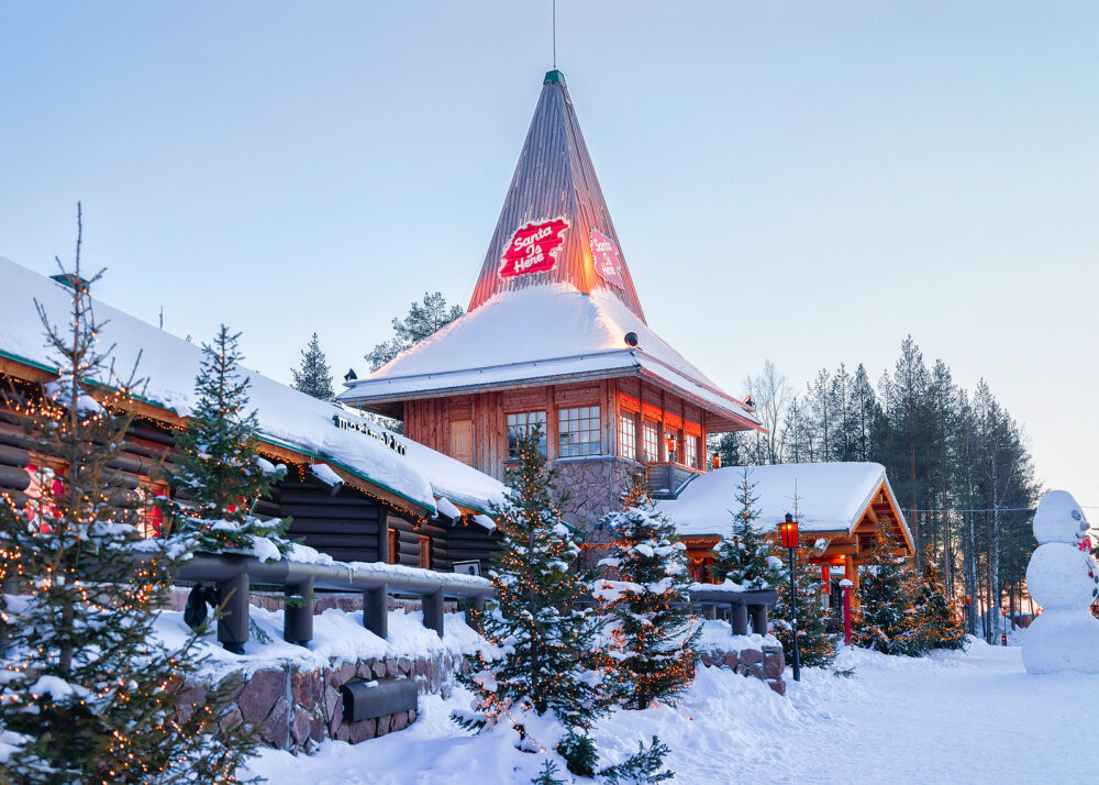 Rovaniemi Finland - Santa Office and Christmas trees in Santa Claus Village Rovaniemi Lapland Finland on Arctic Circle in winter. Outdoor