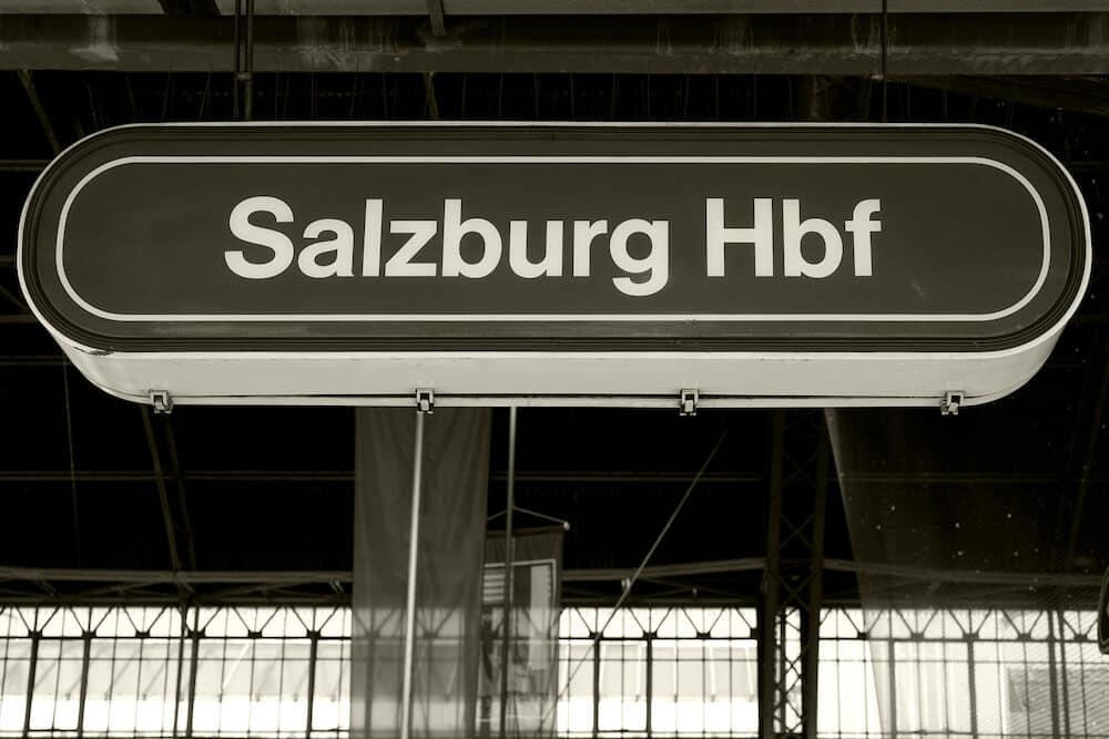 Salzburg train station sign on the platform, Austria