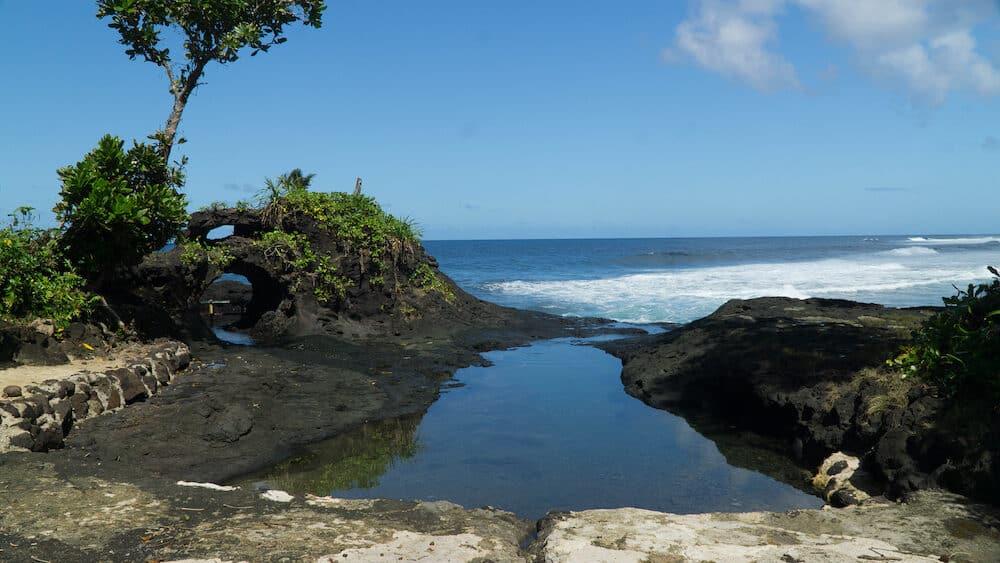 Hidden rock pool made by lava flow, Samoa