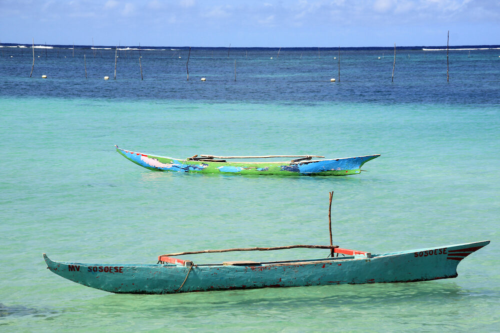 Two traditional wooden boats on the water in Upolu island Samoa
