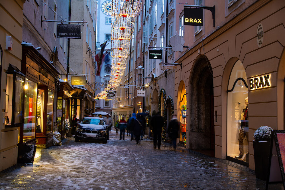 Salzburg,Austria- : Tourists walk in the Getreidegasse street during snow showers