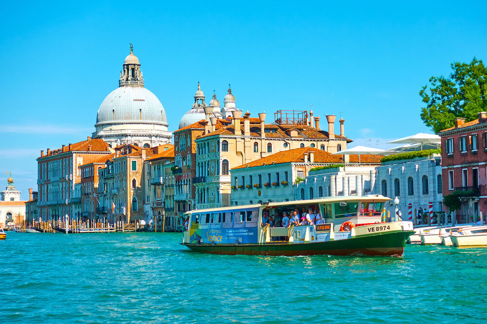 Venice, Italy - : Venetian water bus Vaporetto on the Grand Canal near Santa Maria della Salute church in Venice