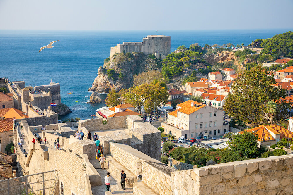 Dubrovnik, Croatia - : View from city walls overlooking walls and sea with cliffs during the day in Dubrovnik in Croatia