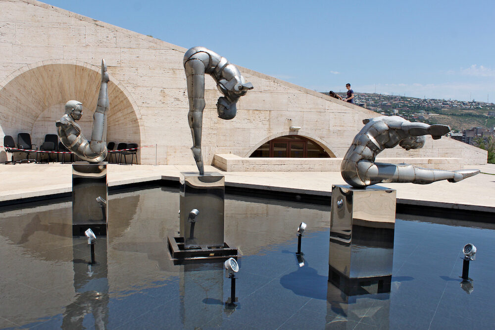 Armenia; Yerevan; Modern art. Stainless steel sculptures of three athletes on top of Cascades in front of entrance door to a museum in Yerevan