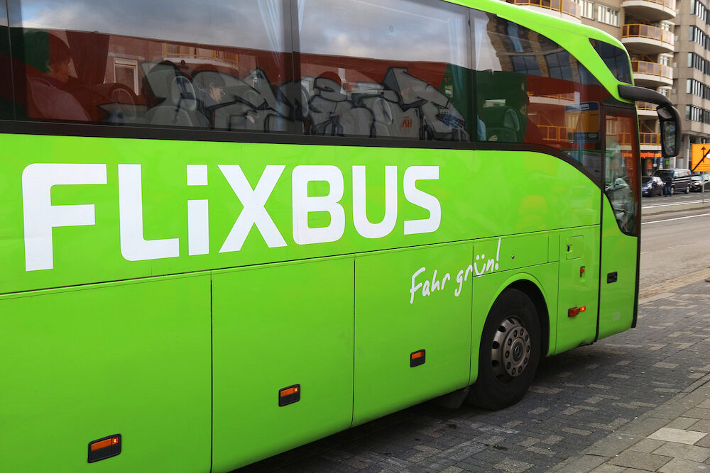 EINDHOVEN NETHERLANDS - People travel on Flixbus coach in Eindhoven. Flixbus is a major European bus company serving 1000 destinations in 20 countries.