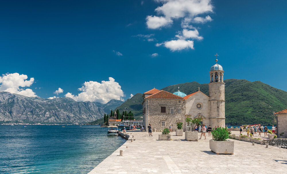 Perast, Montenegro - Our Lady of the Rocks church on an Island in the Bay of Kotor, Montenegro, in a sunny summer day