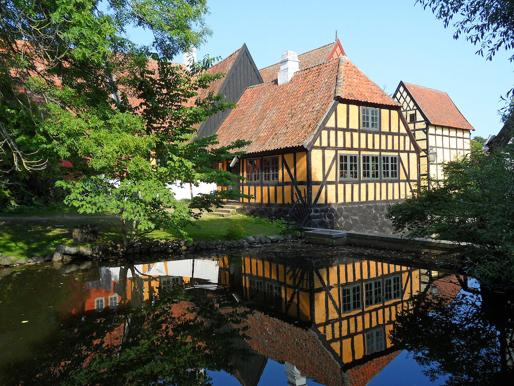 "Reflection of Traditional Houses of the Open-air Museum ""Den Gamle By"" in Aarhus, Denmark"