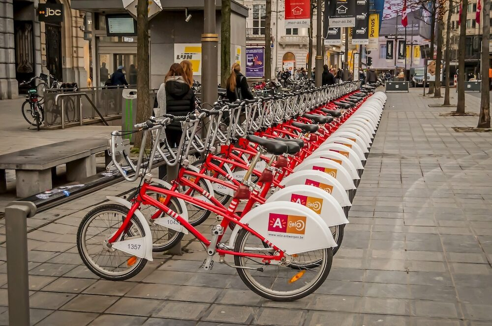 ANTWERP, BELGIUM. . Bicycles lined up at the Antwerp Velo bike rental station at the central Meir street.