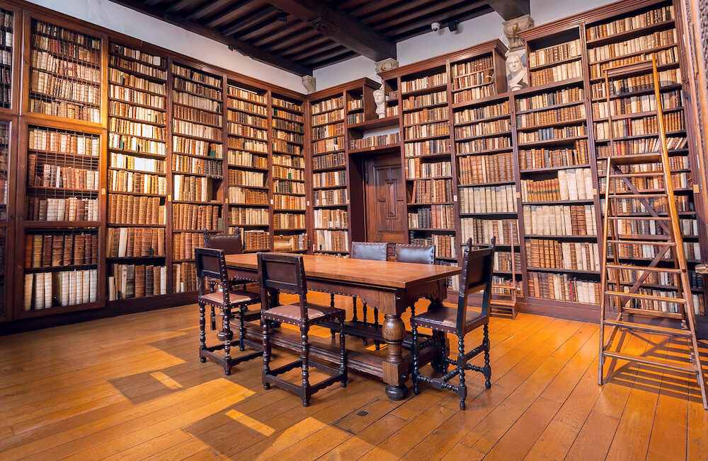 ANTWERP, BELGIUM - Library room with bookshelves with antique books in printing museum of Plantin-Moretus, UNESCO World Heritage Site. More 1,200,000 people lives in Antwerp