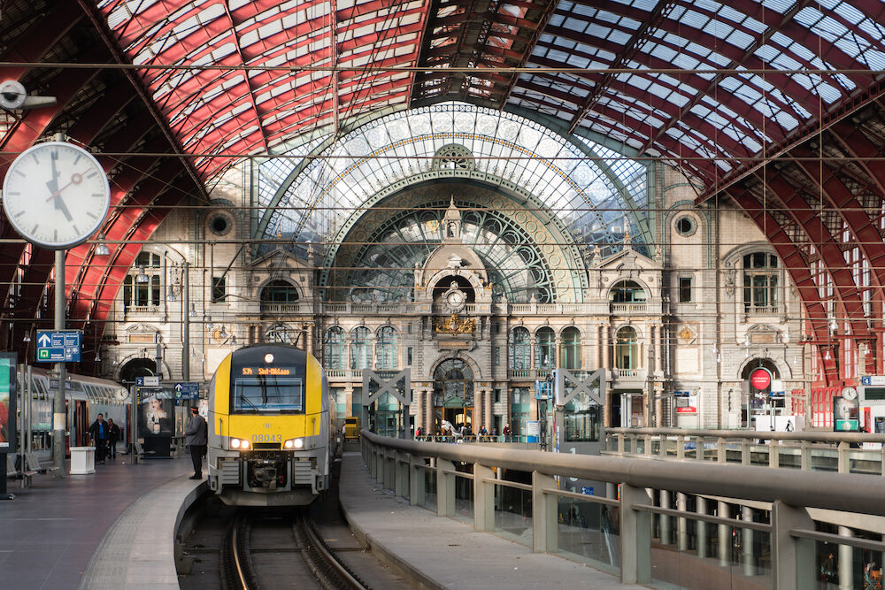 Antwerp, Belgium: The huge glass vault of the train hall of Antwerp Central Railway Station was designed by the architect J. Van Asperen and restored in the 1990s. After replacing or repairing the steel elements, they were painted burgundy.