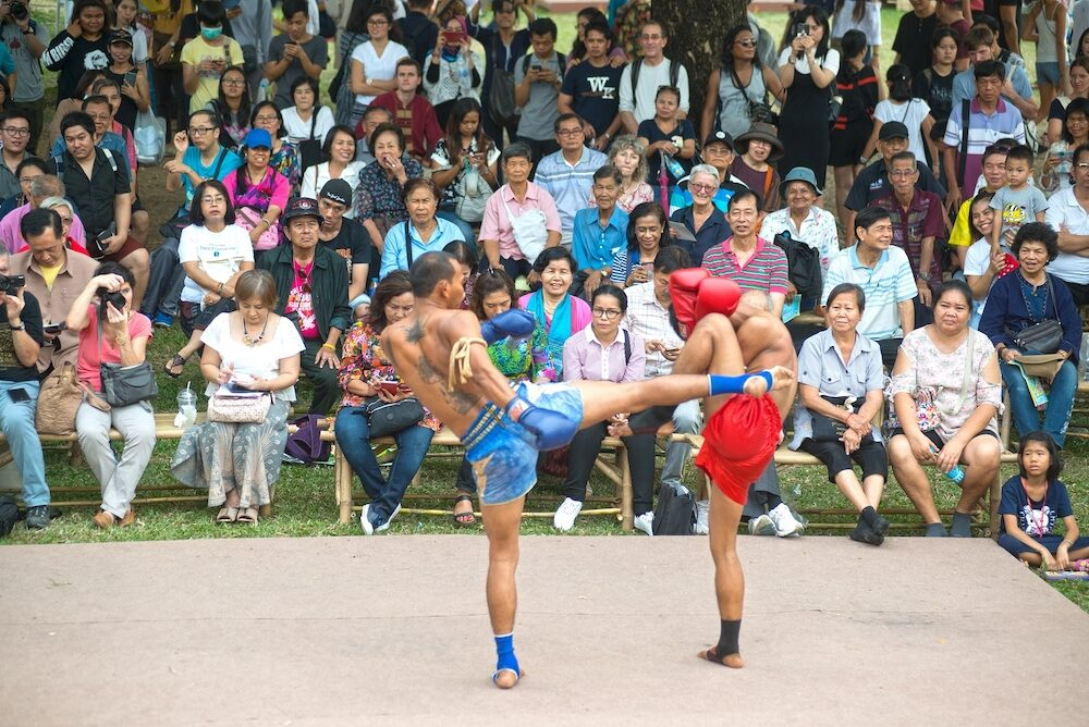 BANGKOK,THAILAND-Unidentified fighter of Martial art of Muay Thai ( Thai boxing ) showing in participants take part in the celebration of Thailand tourism festival at Lumpini park , Bangkok city in Thailand.