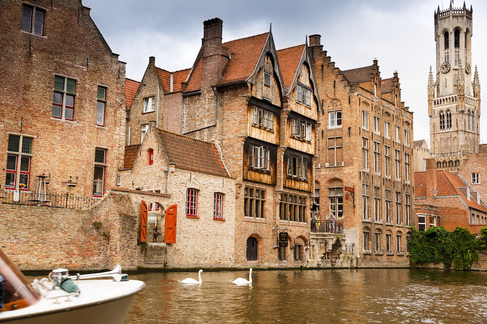 Bruges, Belgium- The Belfry Tower and the medieval houses at the canal in Brugge.