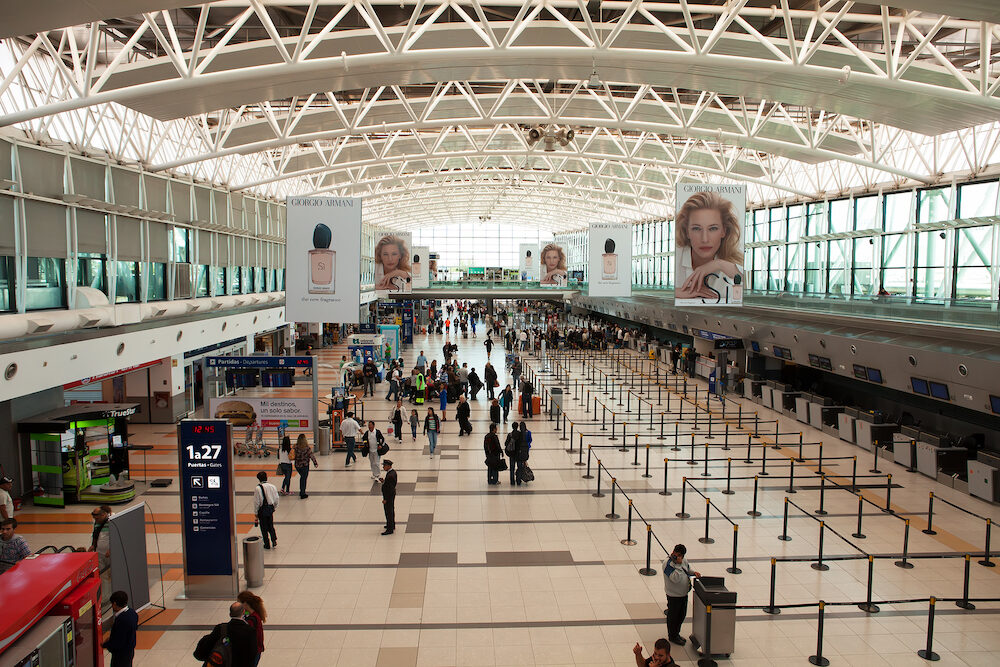 BUENOS AIRES, ARGENTINA -: Passengers await checkin at Ezeiza Airport Terminal A departures