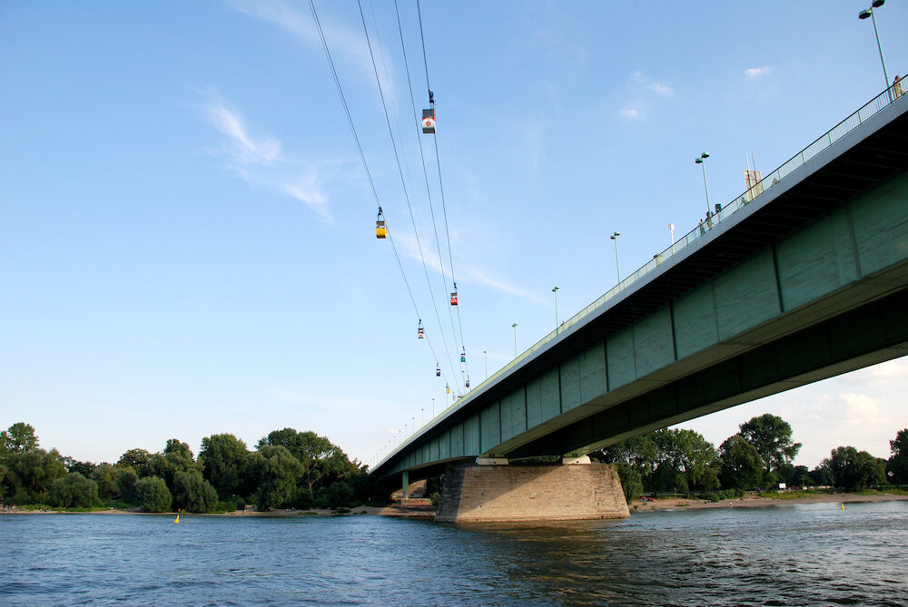 Cable cars cross the Rhine by the Zoobruecke (Zoo Bridge) in Cologne Germany