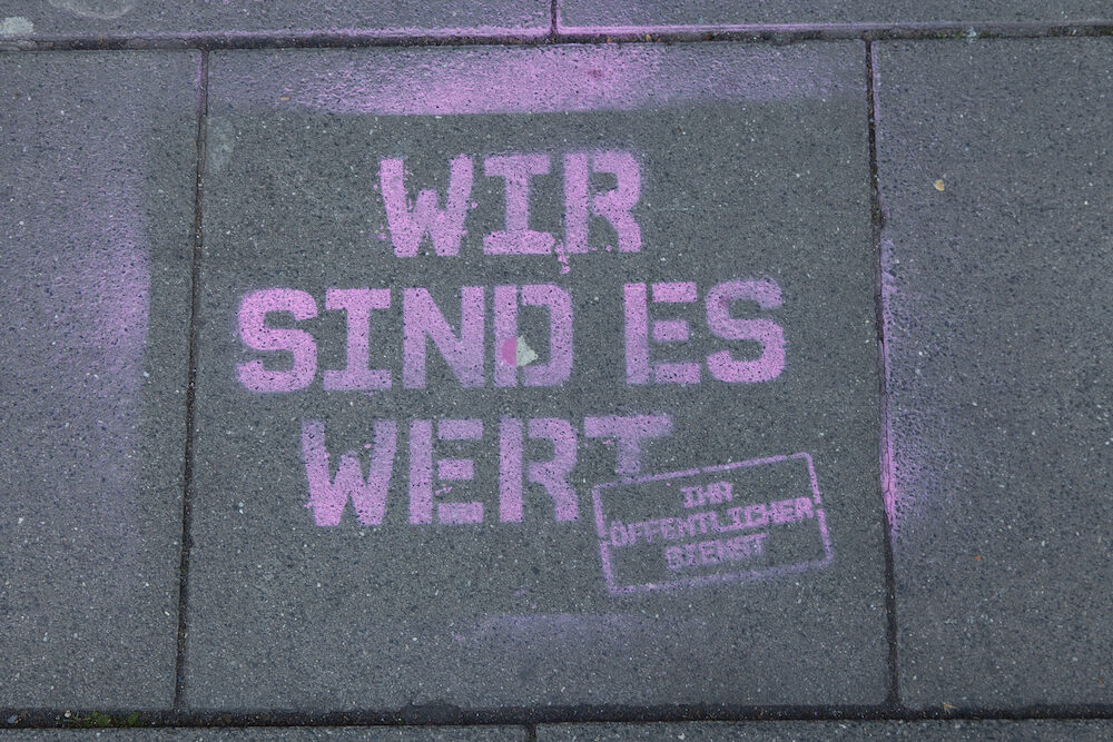 "Cologne Germany - Graffiti on the bottom meaning ""we are worth it - your public service"". This strike was organised by ver.di. They are a large German trade union with 2.2 million members."