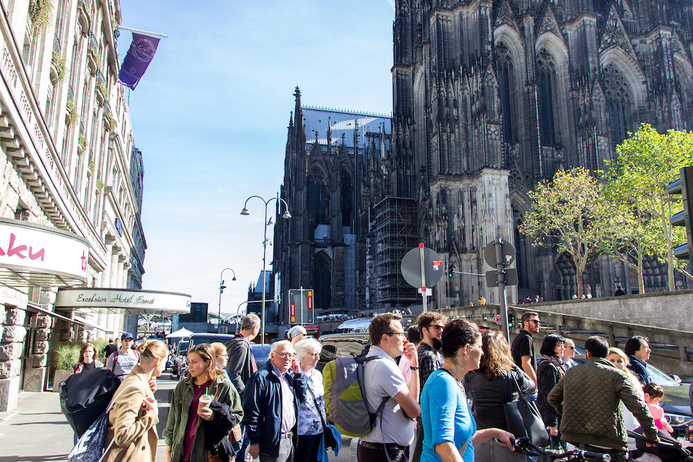 COLOGNE, GERMANY, : Walking tourists on the square in front of the Cologne house. great day