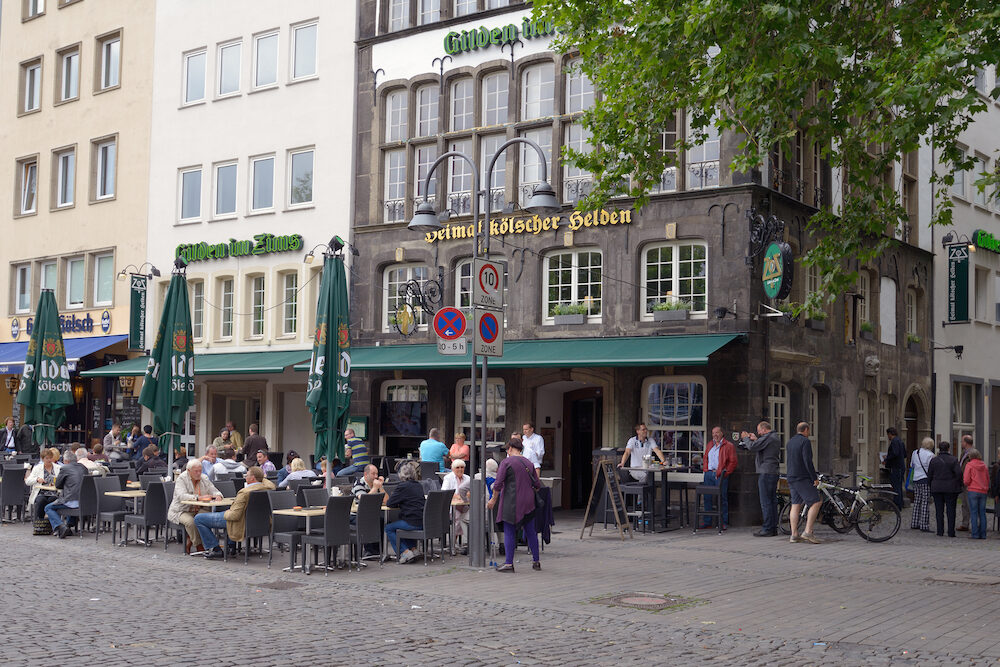 COLOGNE, GERMANY - People resting in the street terrace of the restaurant Gilden in Zims. Founded in 1920, the restaurant was fully renovated in 2006-2009