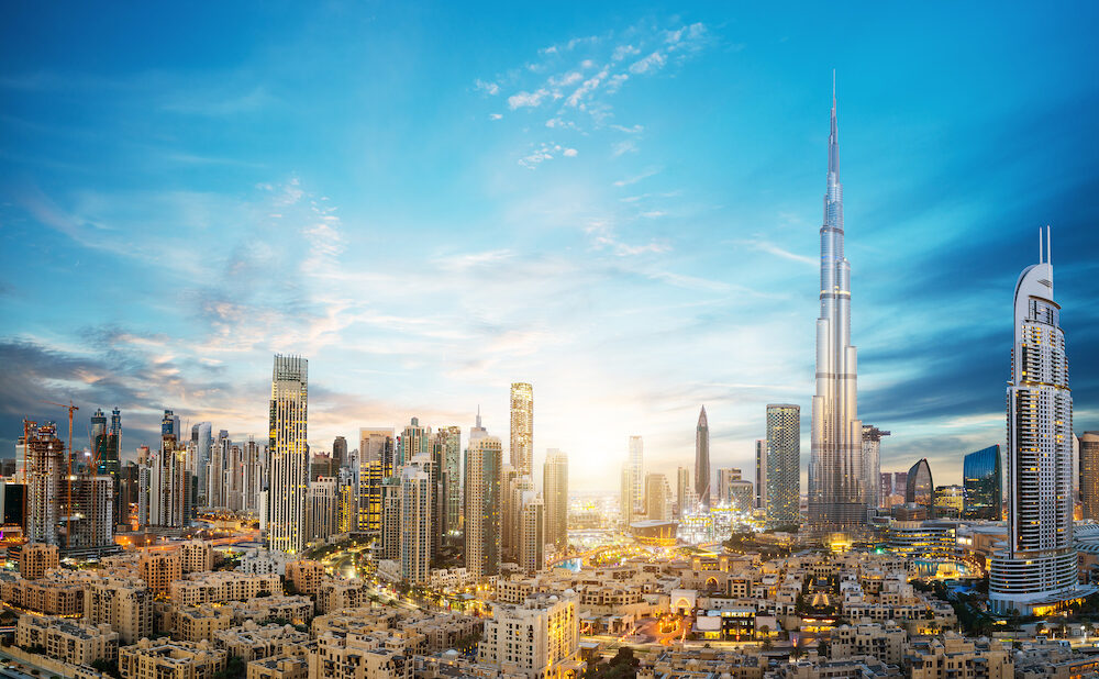 Dubai sunset panoramic view of downtown. Dubai is super modern city of UAE, cosmopolitan megalopolis.