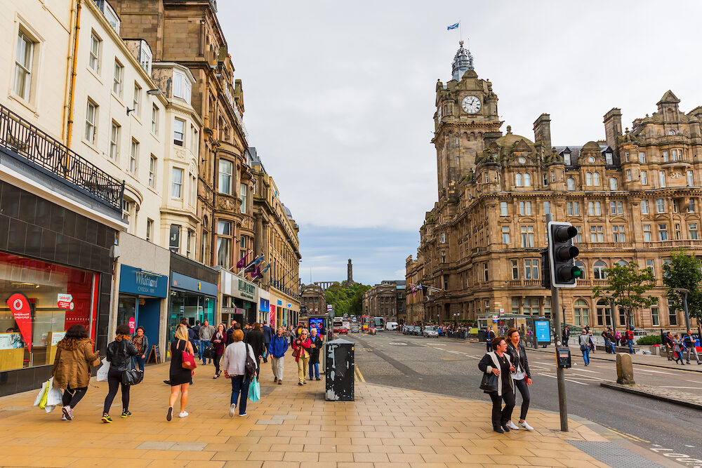 Edinburgh UK - street scene on Princes Street with unidentified people. It is one of the major thoroughfares in central Edinburgh Scotland and its main shopping street