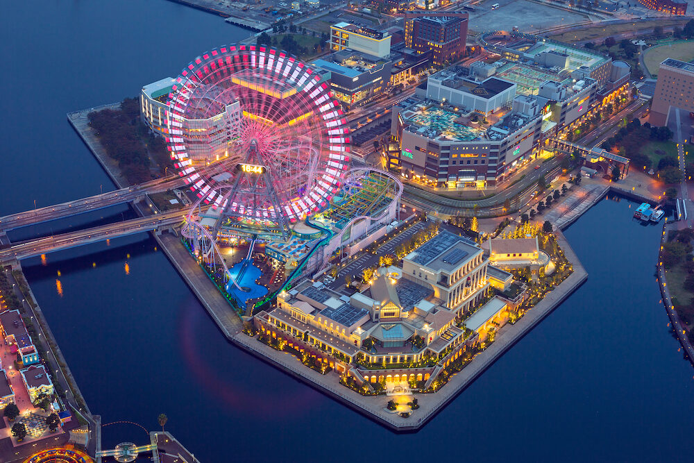 Yokohama, Japan - Aerial view of of Minato Mirai 21 district in Yokohama at night, Japan. Yokohama is the second largest city in Japan by population and most populous municipality.