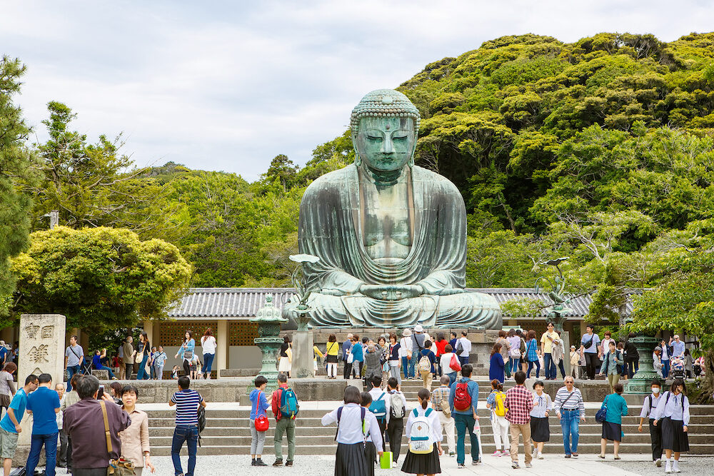 KAMAKURA, JAPAN - The Great Buddha of Kamakura in Kotokuin Temple, Kanagawa, Japan. With a height of 13 meters, it is the second largest bronze Buddha statue in Japan.