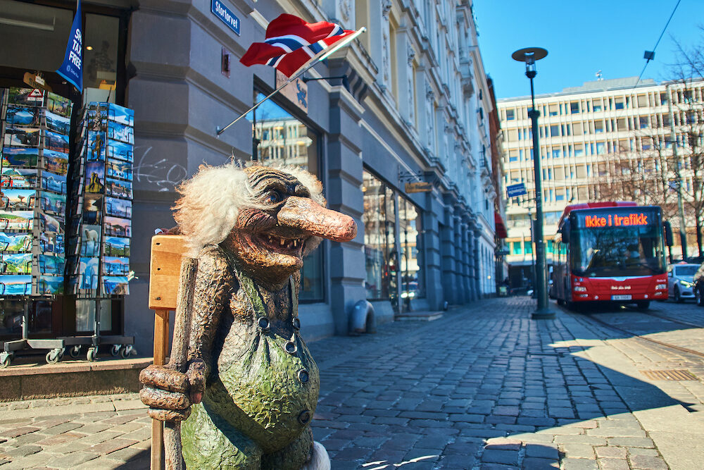 Oslo, Norway: Traditional Norwegian troll figure on the street in front of a souvenir gift shop.