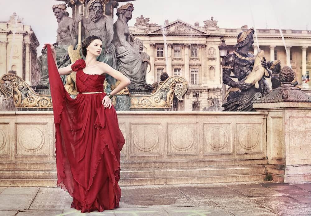 "Beautiful woman in red dress, in public square "" Place de la Concorde, Paris, France"