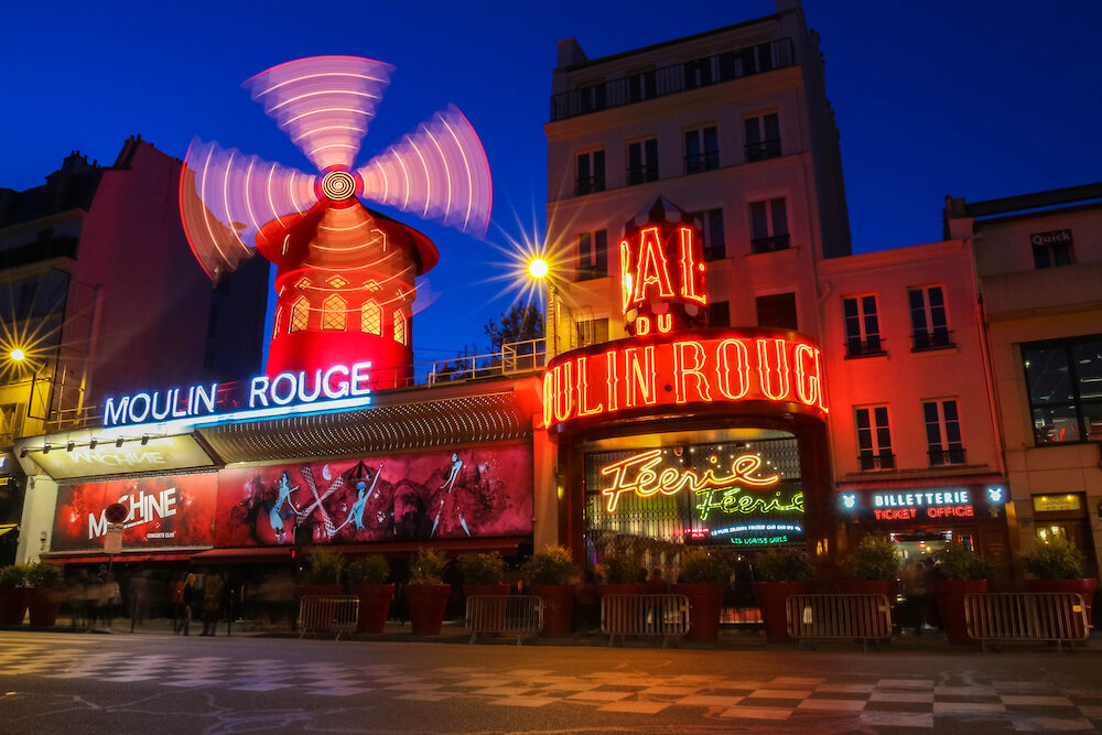 Paris, France-The Moulin Rouge night lights in Paris, France. Moulin Rouge is a famous cabaret built in 1889, locating in the Paris red-light district of Pigalle.