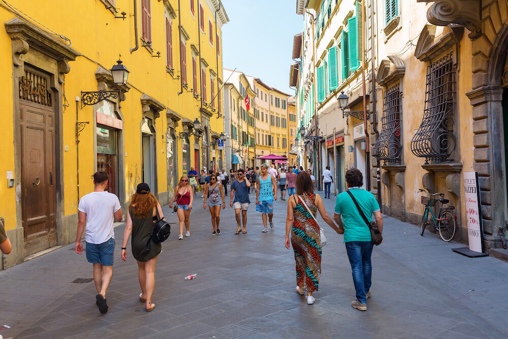 Pisa Italy - Corso Italia with unidentified people. It is the high and shopping street in the heart of the city center