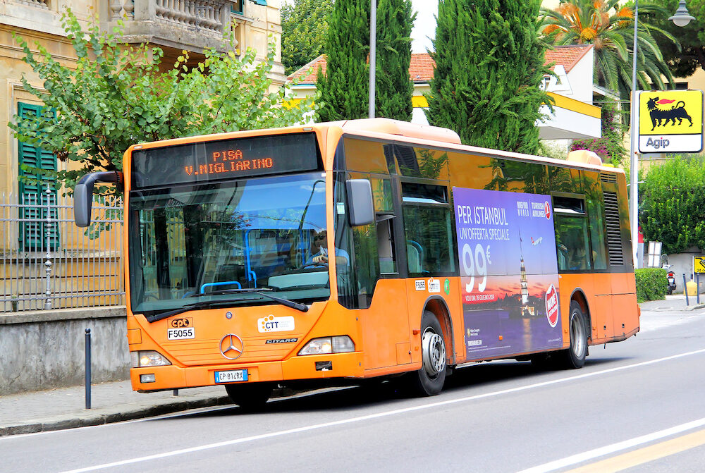 PISA ITALY - Orange city bus Mercedes-Benz O530 Citaro at the city street.
