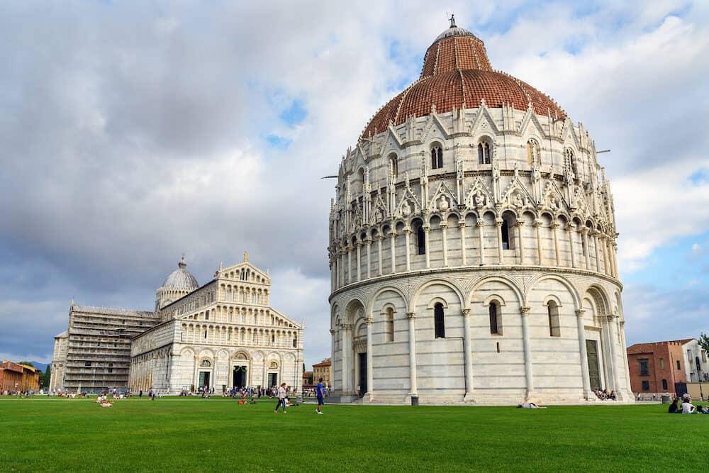Pisa Baptistery of St. John and Cathedral or Duomo di Santa Maria Assunta in Pisa, Italy.