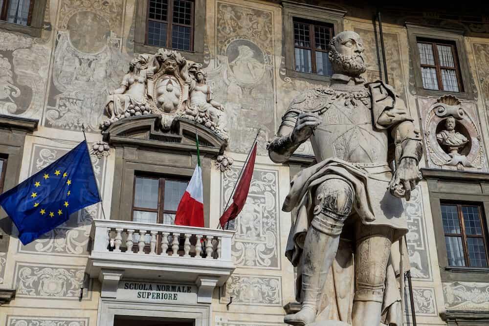 Pisa Tuscany Italy - The Knights' Square ( Piazza dei Cavalieri ) with Palazzo della Carovana and statue of Cosimo I de' Medici in the center of old town