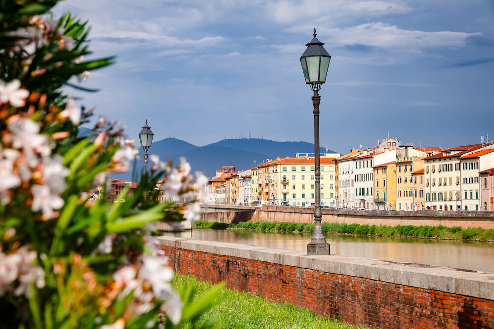 Pisa cityscape with waterfront buldings on Arno River embankment, Tuscany, Italy