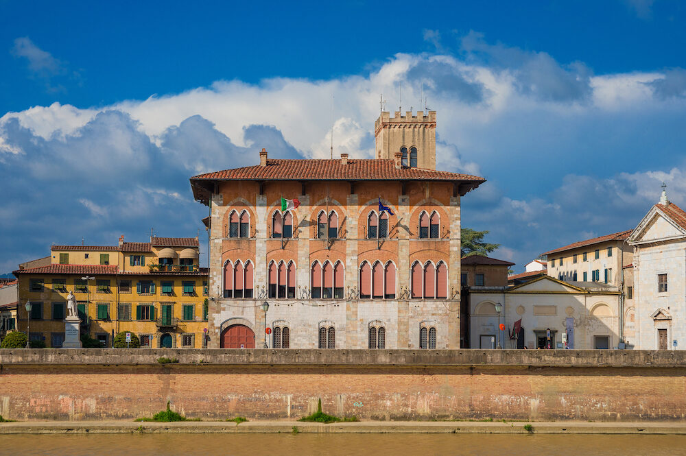 PISA, ITALY - View of Palazzo Medici and National Museum of San Matteo along River Arno in Pisa, Italy