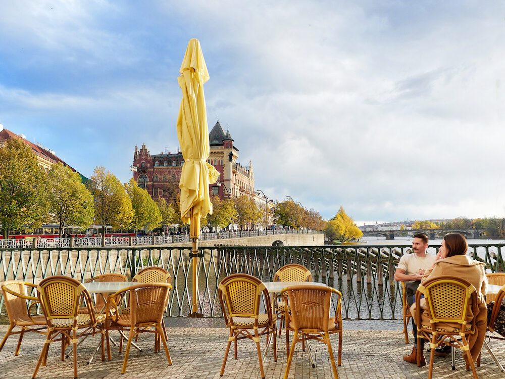 Prague, Czech Republic - , A couple of tourist contemplates Prague Lifestyle in a sunny afternoon fall.