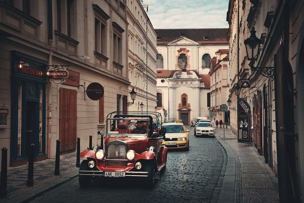 PRAGUE - Street view with vintage car in Prague, Czech Republic. Prague is the capital and largest city in Czech Republic with rich culture and history.