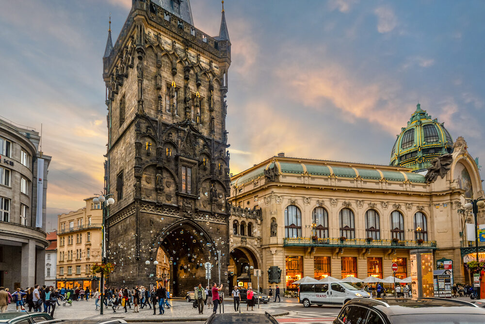 Prague, Czech Republic - The sun sets on the Prague Municipal House alongside the medieval Powder Tower, the gateway between New Town and Old Town in Prague, Czech Republic